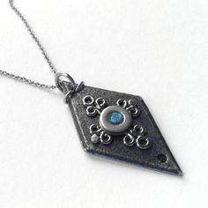 Black Iron Diamond Shaped Pendant, Slate Blue Necklace, Medieval Jewelry, Stainless Steel Center. Beautiful.