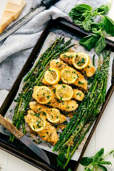 Lightly breaded garlic lemon parmesan chicken and asparagus all cooked on ONE pan. Easy and delicious dinner!