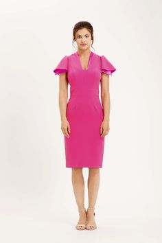 The Camden is a classic pencil dress with open ruffle sleeves and squared v-neckline. There is subtle satin detailing on the neckline and underneath the sleeve, colour matched to the crepe. Hot pink