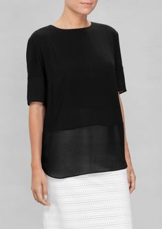 & Other Stories -- Subtly playing with fabric contrasts, this loose-fit blouse features sheer bottom and sleeves that create an airy layer effect on this understated design. Black Blouse, Things To Buy, My Girl, What To Wear, Style Me, Ready To Wear, Tunic Tops, Cos, Loose Fit
