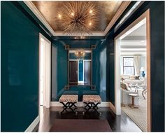 this hallway by Lilly Bunn, it's those glossy peacock blue walls in combination with the gold ceiling, Greek key inspired mirror, and the ur...