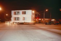 Allan Sekula - Shipyard-workers' housing--built during the Second World War--being moved from San Pedro to South-Central Los Angeles from the series Fish Story - 1990
