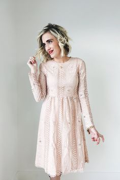 "Blush Lace Midi Dress    Floral Lace Detailing    Long Sleeve     Keyhole Back    Hidden Seam Zipper Under Left Arm    Fully Lined Bodice + Skirt    Also Available in Black    Model is 5'6"" + Wearing a Small"