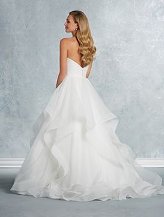 A classic wedding dress with strapless, sweetheart bodice, ruffled hi-lo ball gown skirt, and chapel train.