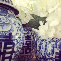 Blue and white pottery filled with white hydrangeas