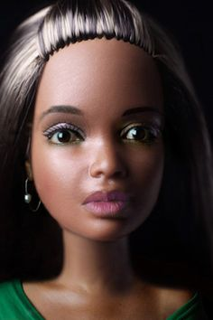Sheila Pree Bright, Plastic Bodies series  Bright contrasts fragmented bodies of multicultural women with the Barbie dolls, blending human and artificial features ,