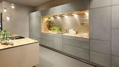 Concrete doors are available for handleless kitchens. Available in light grey and sand. Concrete doors are available for handleless kitchens. Available in light grey and sand. Kitchen Island Decor, Kitchen Doors, Kitchen Cabinet Design, Concrete Kitchen, Kitchen Flooring, Luxury Kitchen Design, Interior Design Kitchen, Modern Kitchen Lighting, Handleless Kitchen