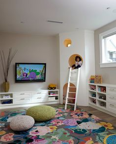 Kids playroom, large floral area rug, knit poufs, custom kids play house with white ladder - Kids Room Ideas Small Playroom, Playroom Design, Playroom Decor, Kids Room Design, Playroom Ideas, Playroom Organization, Organization Ideas, Colorful Playroom, Small Kids Playrooms