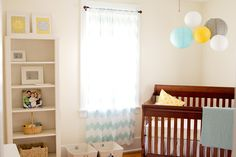 Robin's egg blue, yellow, and gray nursery. Chevron curtains from Urban Outfitters.