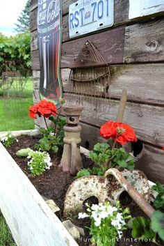 Superbe Rusty Garden Tools Leaning Against A Rustic Shed As Garden Art, Inside A  Flowerbed With Red Geraniums