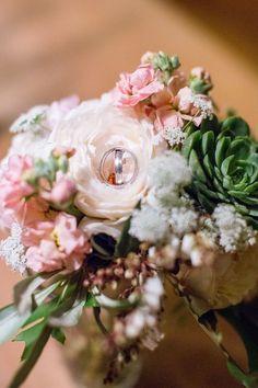 groom-rings-on-flowe