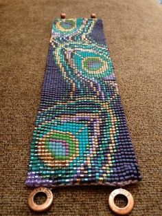 Bracelet plumes de paon sur mesure par beadifuljewelry sur Etsy