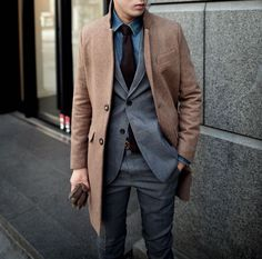 Shop this look on Lookastic:  http://lookastic.com/men/looks/denim-shirt-tie-blazer-overcoat-gloves-dress-pants/5778  — Blue Denim Shirt  — Dark Purple Tie  — Charcoal Blazer  — Brown Overcoat  — Brown Leather Gloves  — Charcoal Dress Pants