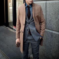 Shop this look on Lookastic: http://lookastic.com/men/looks/denim-shirt-tie-blazer-overcoat-gloves-dress-pants/5778 — Blue Denim Shirt — Dark Purple Tie — Charcoal Blazer — Brown Overcoat — Brown Leather Gloves — Charcoal Dress Pants