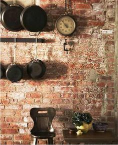 Like the exposed brick paired with the dark of the cast iron skillets. Simple, warm, but still inviting. Brick Wall Kitchen, Old Brick Wall, Brick Accent Walls, Exposed Brick Walls, Kitchen Decor, Kitchen Ideas, Kitchen Craft, Taco Bar, Decorating Tips