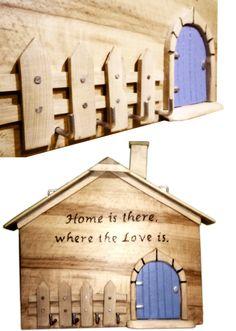 Wooden house- key hanger with burned inscription.