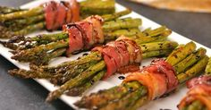 Bacon-Wrapped Asparagus- Bacon-Wrapped Asparagus Easy elegant appetizer to make your next dinner party extra fancy: crispy roasted asparagus spears bundled in bacon and drizzled with honey balsamic glaze. Easy Asparagus Recipes, Bacon Wrapped Asparagus, How To Cook Asparagus, Asparagus Spears, Elegant Appetizers, Dinner Party Appetizers, Dinner Party Meals, Fish Dinner, Dinner Parties