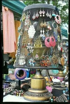 This is a really neat idea to hang earrings from. On top of a dresser or if you have a fabulous actually designed walk-in closet. You could hang little hooks on it too, for necklaces and bracelets. Just paint or paper an antique lamp base and the basket on top to match the room decor. Not only do you have quick and easy access to your jewelry so you're not digging through drawers.  But you can show them off and make them part of the room.