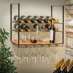 12 Bottle Wall-Mounted Wine Rack And Stemware HolderSpace-saving simplicity. This wall-mounted wine rack holds 12 bottles and up to 12 wine stems. Wood shelf provides the perfect place to store, display and serve. Antiqued iron frame with pine shelf. Hanging Wine Glass Rack, Wine Rack Wall, Diy Wine Racks, Wine Rack Shelf, Hanging Bar, Wine Shelves, Wine Storage, Crate Shelves, Record Storage