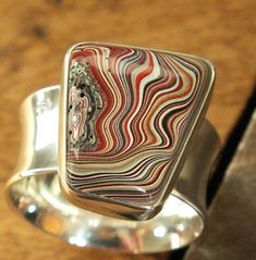 Fordite / Detroit Agate, Motor Agate comes in bright colors and psychedelic swirls, and are often crafted into eye-catching jewelry. But Fordite is not a gemstone, rather it is dried paint that built up, layer upon layer, in factories that painted automobiles long ago