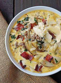 Zuppa Toscana Olive Garden Copycat Soup Recipe is a popular soup made with sausage, potato, bacon, kale, and heavy cream. Always a hit!