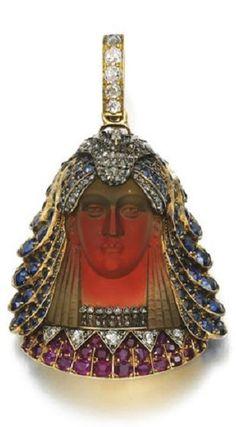 TIFFANY & CO. Art Deco Egyptian Pendent ..Hardstone, gem set and diamond pendant/brooch, Tiffany & Co., 1870s..