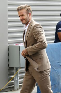 davidbeckhamhq:   David Beckham arrives at the... - Black suit