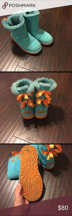 💯 Tiffany blue uggs with orange ribbon bows Gently used, still in great condition. UGG Shoes Winter & Rain Boots