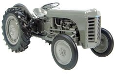 Ferguson tractor... As a boy I rode plenty of miles straddled the hood of the ole furgey facing to the rear studying my grandfathers weathered face as he raked hay... OSHA approved it wasn't but I am so glad I had hat time...