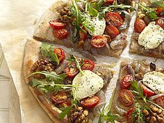 How to Make Pizza With Arugula and Goat Cheese | This healthy homemade pizza features whole-wheat pizza crust topped with flavorful goat cheese, spicy arugula greens, and halved grape tomatoes.