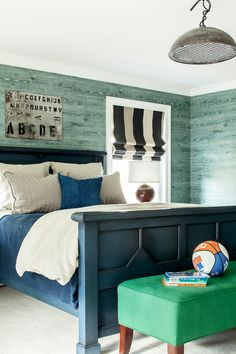 Boys bedroom, teal wood wall paneling, blue bed, green bed bench   ML Interior Designs