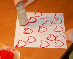 Bend/fold an empty toilet paper tube into a heart shape.  Ours stayed without being taped or anything, but you might try that if yours doesn't stay.  Dip in paint and stamp on paper.  We used red Crayola washable tempera paint squirted onto a clean plastic lid (from a 32 oz. yogurt container).
