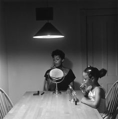 Carrie Mae Weems' Untitled (Woman and daughter with makeup), from Kitchen Table Series, 1990