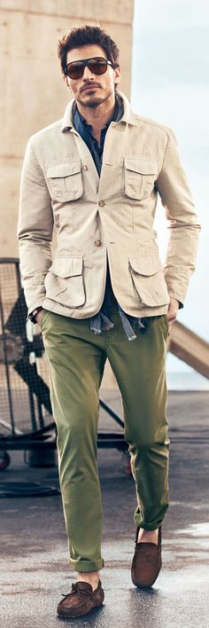 Safari jacket with external breast pockets, green chinos (coloured cotton pants), brown moccasins and a scarf draping along the torso underneath the jacket. Mens Fashion Blog, Fashion Outfits, Men's Fashion, Fashion Spring, Fashion Clothes, Mode Outfits, Fashion Photo, Fashion News, Fall Outfits