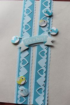 Its a Boy Stack Pack and embellishments. CM's double heart chain bordermaker cartridge