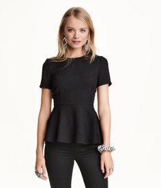 Black, short-sleeved, textured peplum top in a  stretchy woven fabric with visible back zip. | H&M Divided