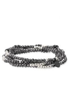 Jessie stretch bracelet set by Stella & Dot. Photo of 5 faceted glass & metal beaded stretch bracelets.