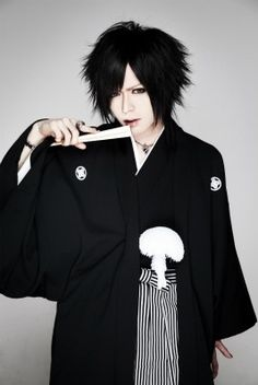 Yo  Ka -DIAURA I don't really like their music but I like to watch the videos because he is really freaking spastic and its fun to watch his face when he sings and the way he jerks his body when he dances.