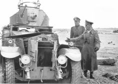 The commander of the German Afrika Korps, General Erwin Rommel, accompanied by an officer examines the British armored rolls-Royce, captured in Cyrenaica, North Africa. Pin by Paolo Marzioli Army Vehicles, Armored Vehicles, Armored Car, Afrika Corps, Erwin Rommel, Panzer Iii, Battle Tank, Military Diorama, World War One
