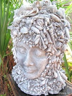 SBG thinks she could make this for peanuts on a manequin head or a wig form. shells and paint on terra cotta form #outdoor #bust #head
