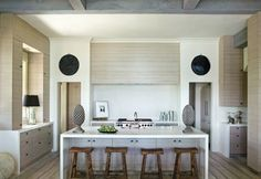 """@jincy futrell, this is the kitchen with the """"vanishing cabinets""""   to all the kids out there, the wall in the bakc is the hood over the range. hidden by gorgeous wood."""