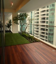 Apartments, Apartment Balcony Decking Emerald Green Fiber Rug Dual Yarn Shaggy Rug Green Thick Glass Balcony Railing Recessed Deck Lighting Led Ceiling Hanging Lamps Wooden Laminate Flooring Ideas White Ceiling: Elegant and Comfortable Wooden Apartment Balcony Decking