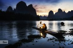 The famous Mr. Huang of Xingping in China.  It was almost a surreal experience meeting him and even having the opportunity to get on his bamboo raft. Xingping has become very populated with Chinese tourists but it still has its charms during sunrise and sunset hours when the river and streets become empty.