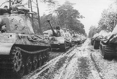King Tigers lining the road during the lead up to the fighting to capture the port of Antwerp in what is referred to as The Battle of The Bulge.