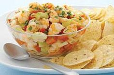 Shrimp Ceviche recipe - This chic appetizer with cooked shrimp and zesty lime juice would be right at home at a breezy cafe with an ocean view. Happily, it's at your home instead.