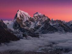Arakam Tse and Cholatse tower above the Ngozumpa Glacier in the Gokyo Valley - Nepal.