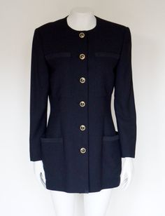 Hello Im glad youre here PANDORA FASHION  I offer vintage GIANNI VERSACE COUTURE jacket AUTHENTIC ! composition 90% virgin wool 10% silk color:navy blue Made in Italy 42(italian size) in my opinion medium used in very good condition   total length 79 cm/ 31,10 inch width shoulders 41 cm/ 16,14 inch width armpit to armpit 50 cm/ 19,69 inch width waist 42cm/ 16,54 inch length sleeves 60 cm / 23,62 inch length sleeve from armpit 43 cm/ 16,93 inch  If you have any qu...