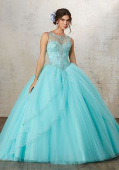 Accented with Jeweled Beading, Tulle Quinceañera Ballgown Features an Intricately Beaded Bodice with Jewel Illusion Neckline. Matching Stole. Keyhole Corset Back