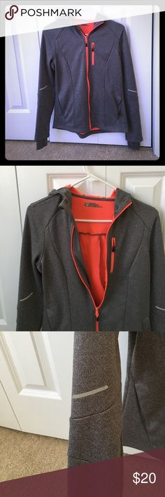 Gray workout zip up hoodie from tj maxx Gray workout zip up hoodie with bright orange zipper accents and a bright orange interior. Good condition although is missing the drawstring at the hood. Thumb holes to keep the hands comfortable. monde Tops Sweatshirts & Hoodies