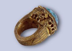 Ring with the Arms of Aragon and Naples Name: Ring with the Arms of Aragon and Naples Place of creation: Italy Date: Mid-15th century School: Naples Material: bronze, aquamarine and foil Technique: cast, chased, engraved and gilded Dimension: 5,7 cm